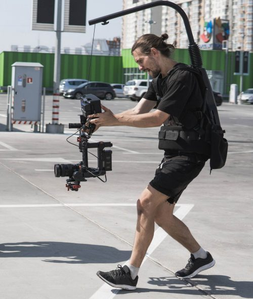 Image of our staff at Elite Video of Rochester shoowing some footage out in a parking lot.